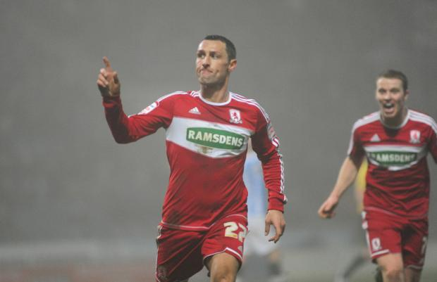 NO THREAT: Boro striker Scott McDonald when he scored his sides first goal against Huddersfield Town