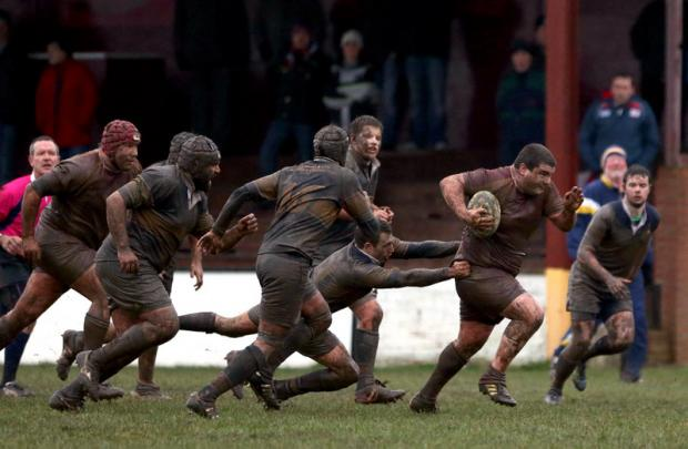 ON THE CHARGE: Middlesbrough hooker Benn Horton breaks through the Old Crossleyans' defence