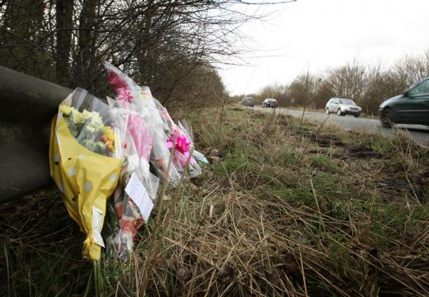 Flowers are left at the scene of the accident by the side of the A66 Bridge Road in Darlington