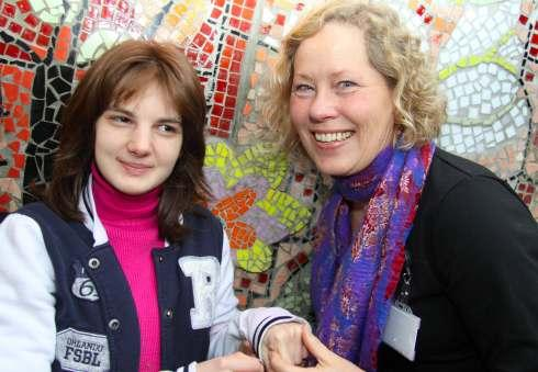 Head teacher at The Dales School Hanne Barton and student Robin Plowright, 16, of Thirsk, admire one of the mosaics created by art makers at Henshaws