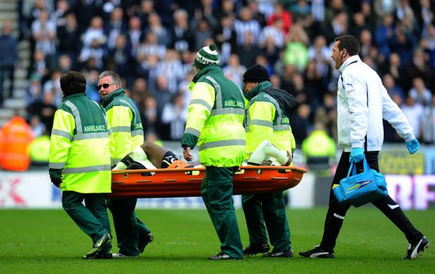Newcastle United's Massadio Haidara is carried from the field on a stretcher after a horror tackle by Wigan's Callum McManaman