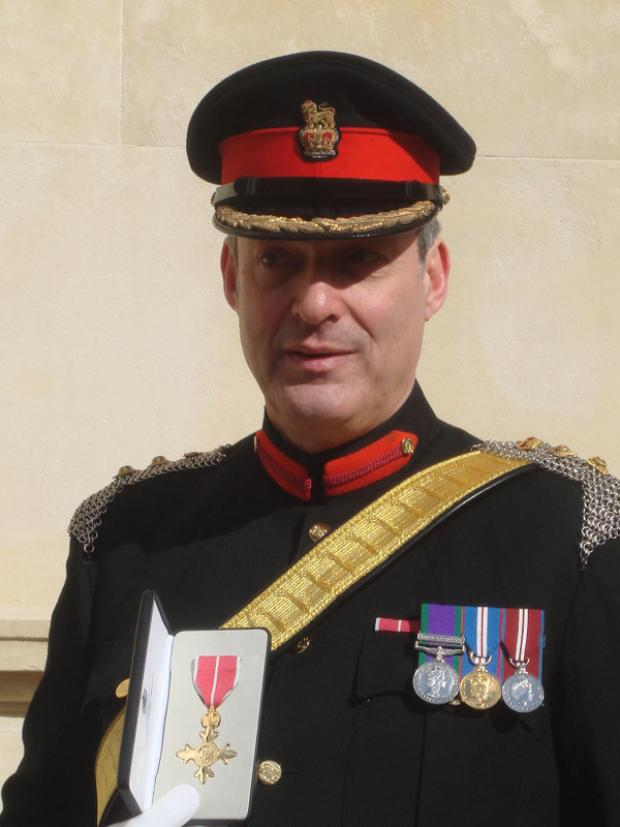 HONOURED: Colonel Nick Millen with his OBE