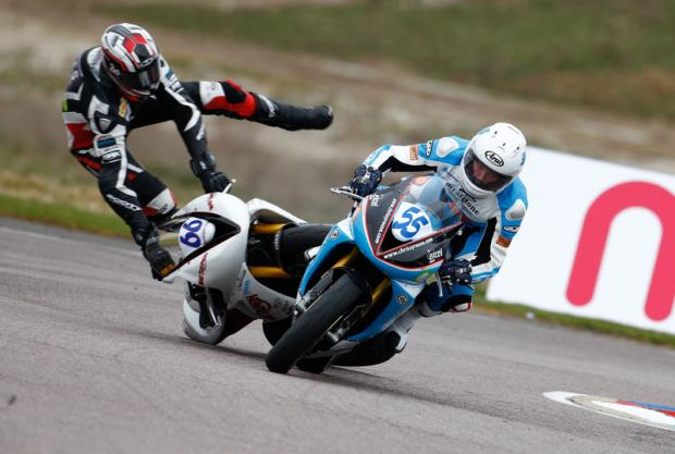 SPECTACULAR FALL: Freddie Pett crashes out of the Triumph Triple Challenge at Thruxton last weekend after touching Chrissy Rouse's rear wheel.