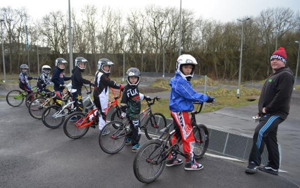 Darlington and Stockton Times: READY TO GO: Tom Whipham with riders from The Hub Club, which will host a major BMX race day next month.