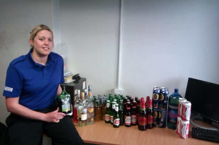 PCSO Sarah Stephenson with some of the alcohol seized from teenagers drinking at Broken Scar
