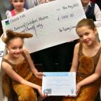 Butterwick Children's Hospice Shop, Skinnergate, Darlington  -  Kids from Tiffany School of Dance present Butterwick Children's Hospice shop manager June Teasdale (centre) with the cheque, surrounded by (clockwise from bottom left) Molly Crick (11), Evely