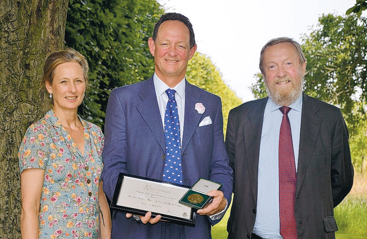 RECOGNITION: from left, Ros and Charlie Forbes Adam and Sir John Beddington