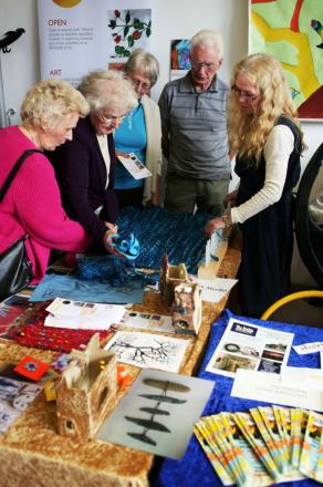 Open art studio manager Bonnie Davies (right) gives a textile demonstration to visitors during the first birthday open day at The Bridge arts centre in Darlington (file pic)