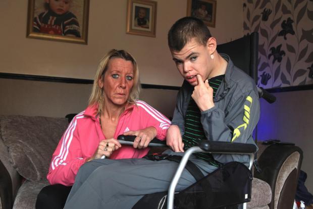 Ryan Norman, 20, with his mother, Ceneta