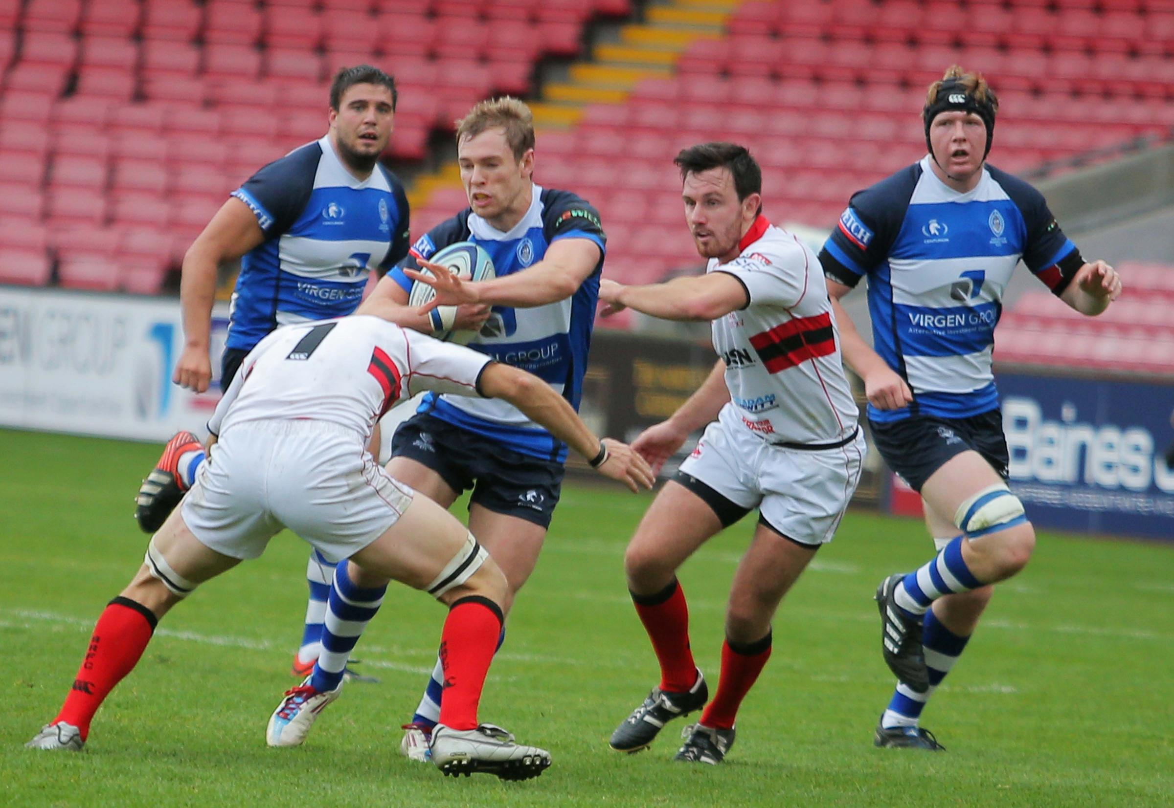 POWERING ON: Mowden Park's Chris Pease fends off Bromsgrove's Luigi Belmonte on Saturday