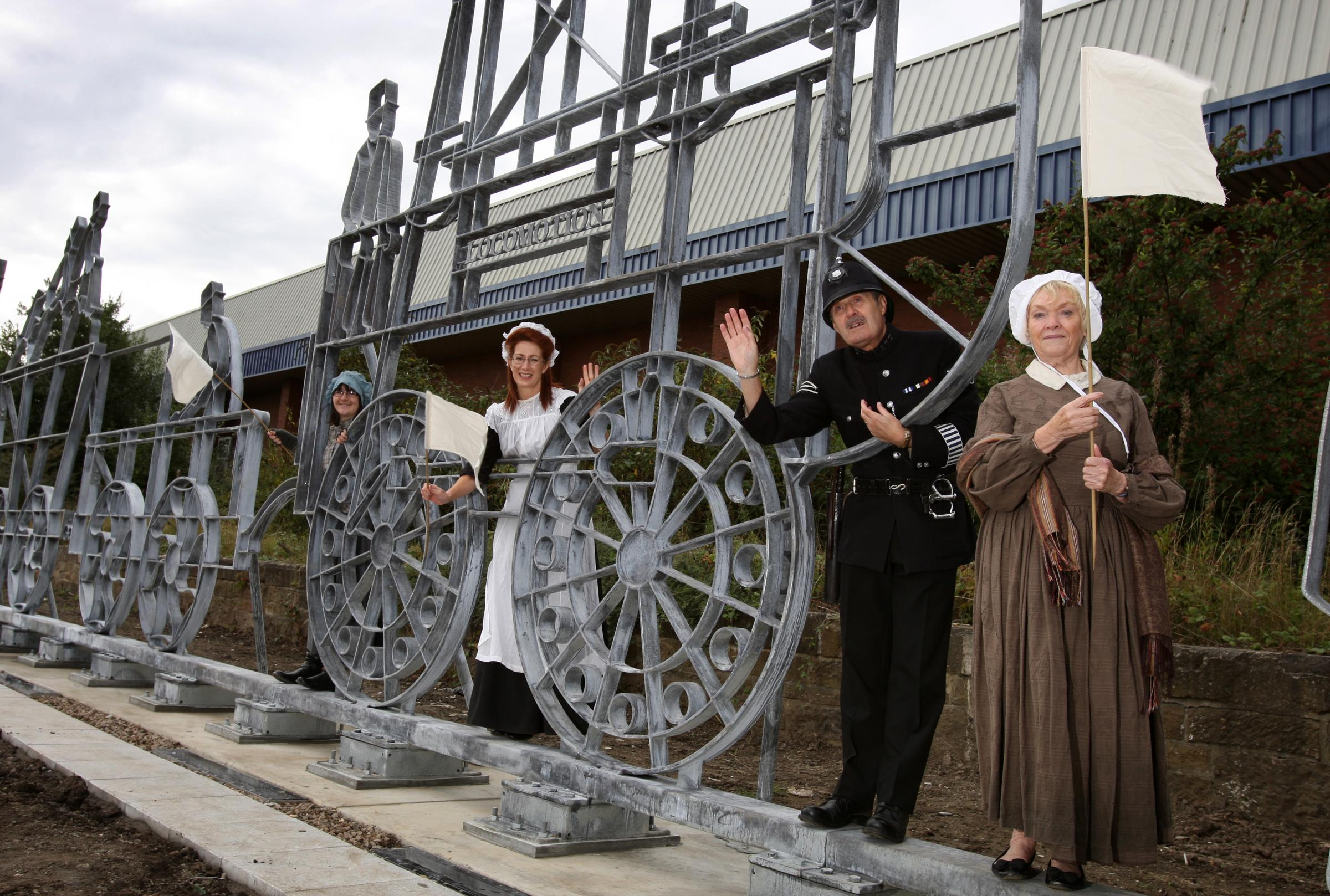 Victorian re-enactors with the new life-sized sculpture of the first train to travel along the Stockton-Darlington Railway, which has been installed next to the new St John's Crossing junction in Stockton.