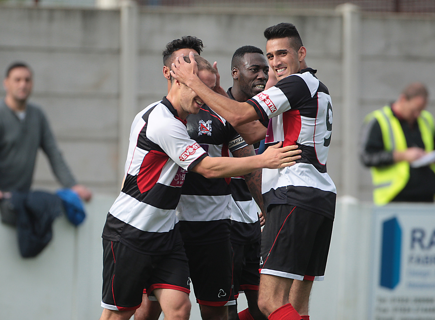 MOORE MAGIC: Chris Moore, left, is congratulated on scoring one of his two goals for Darlington