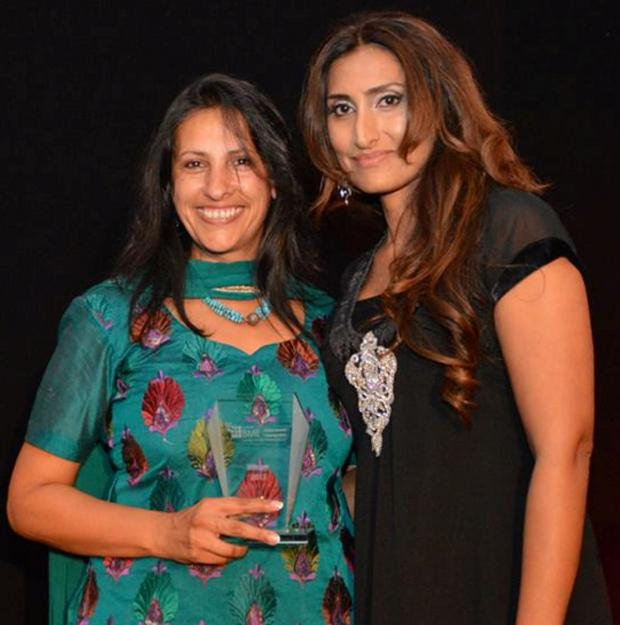 Darlington and Stockton Times: TOP COP: Superintendent Kerrin Smith (left) received her BME Network Woman of the Year award from Yasmin Khan, diversity officer for Housing Hartlepool.