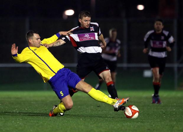 Darlington and Stockton Times: LEADING THE WAY: Steven Johnson, Darlington's captain for the night, is tackled by Sunderland RCA's Liam Clough