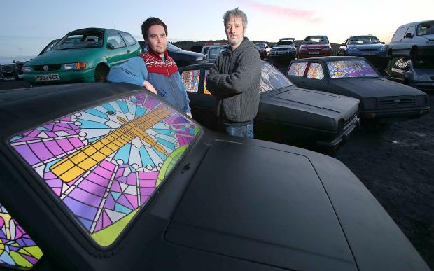 BRIGHT IDEA: Artists Stuart Langley, left, and Matt Sayle, of Twist Design, get their Robin Reliants ready for next week's Lumiere Festival, in Durham City. Below, some of the window designs