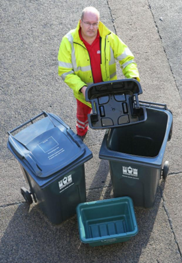 Darlington and Stockton Times: Street Scene team leader Dave Hutchinson with the proposed collection pack for the majority of Darlington households; wheelie bin on left for general rubbish, small green box for glass, smaller wheelie bin for recycling with caddy for paper
