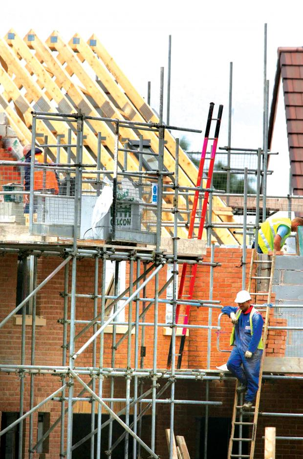 Darlington and Stockton Times: HOUSE PLANS: Builders at work on a housing development. Library image.