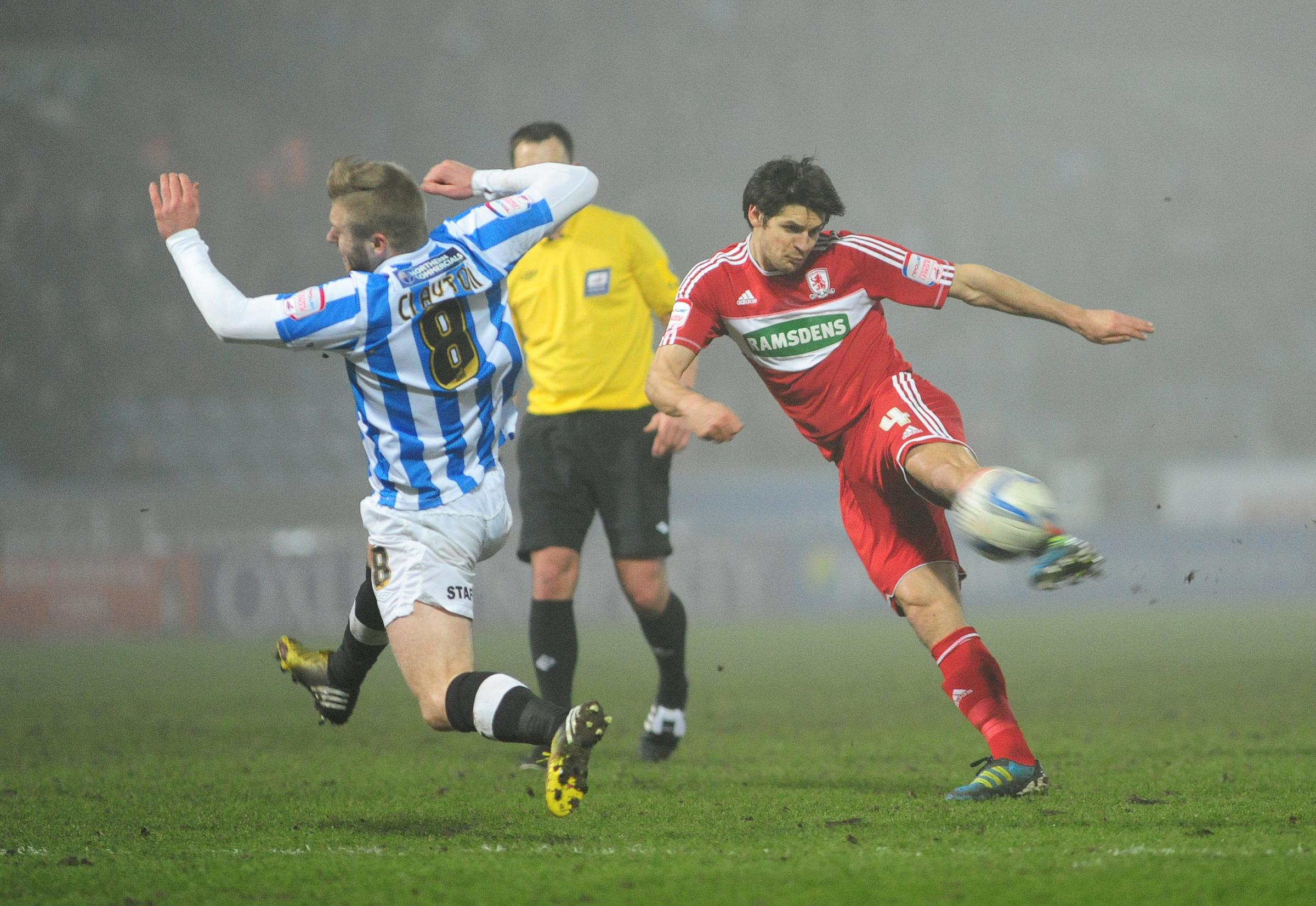 Huddersfield Town's Adam Clayton tries to block a shot from Middlesbrough's George Friend in a Championship match at the John Smith's Stadium last season