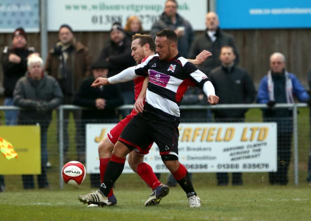FIRST STRIKE: Stephen Thompson, scorer of the first goal, muscles past an Ossett Town defender