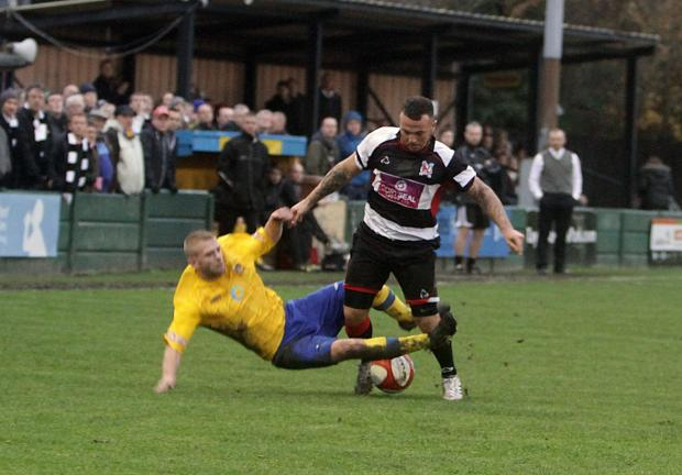 Darlington and Stockton Times: TWO-FOOTED TACKLE: Darlington's Stephen Thompson is fouled by Warrington's David Thompson