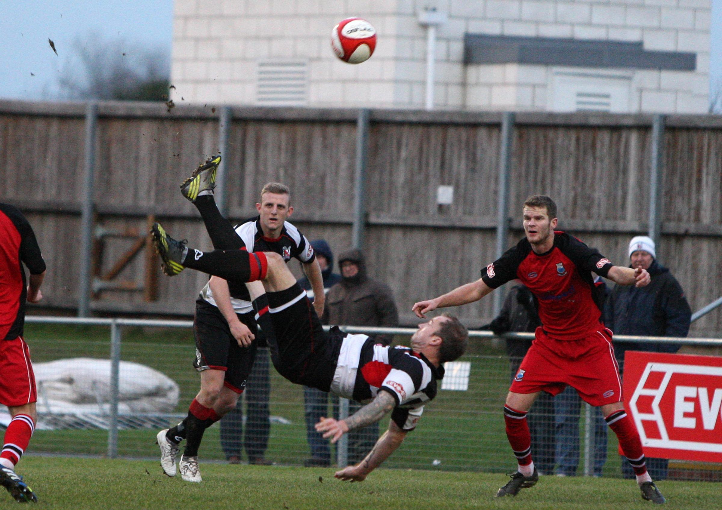 AMBITIOUS EFFORT: Darlington defender Alan White attempts to score with an overhead kick against Bamber Bridge on Saturday