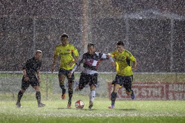 Darlington and Stockton Times: RAIN STOPS PLAY: Darlington's Stephen Thompson battles to maintain possession in the heavy rain which eventually led to last night's friendly with Sunderland being abandoned