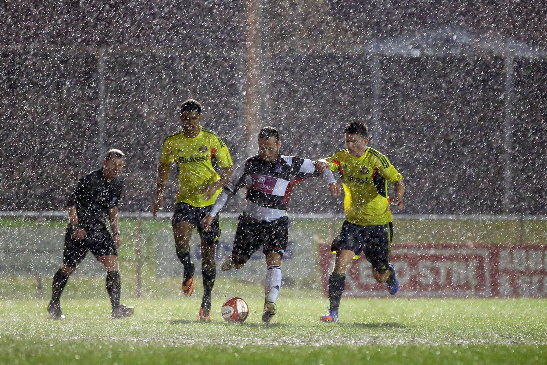 RAIN STOPS PLAY: Darlington's Stephen Thompson battles to maintain possession in the heavy rain which eventually led to last night's friendly with Sunderland being abandoned