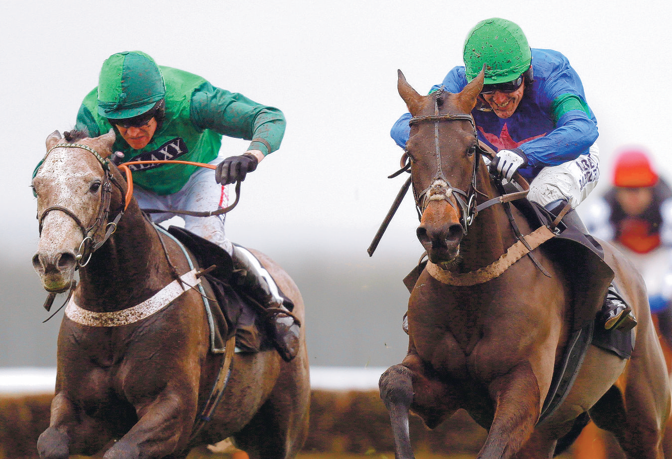 BATTLE: Dawalan ridden by Barry Geraghty (left) with Rayak ridden by Tony McCoy on their way to victory in the Blackmore Building Juvenile Hurdle during the Christmas Raceday at Newbury Racecourse