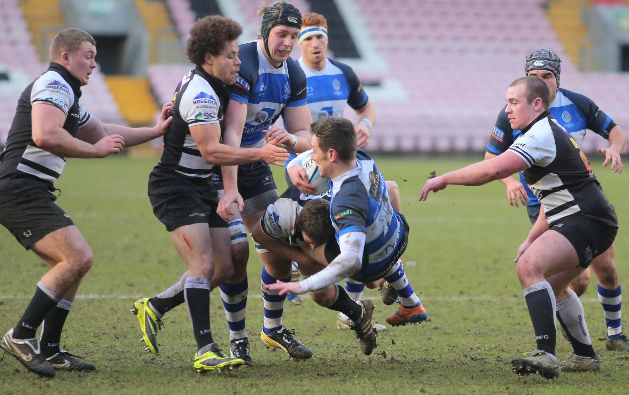 UNDER PRESSURE: Mowden Park's Gav Painter is tackled by the Luctonians' opposition on Saturday