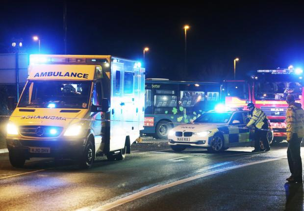 Emergency services on the scene of the collision on Saturday