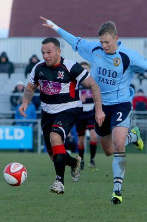 CLOSE CONTROL: Stephen Thompson, scorer of the Quakers' first goal, dribbles away from Richard Smith