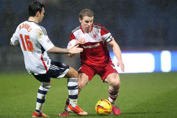 MIDFIELD BATTLE: Bolton Wanderers' Mark Davies and Middlesbrough's Grant Leadbitter