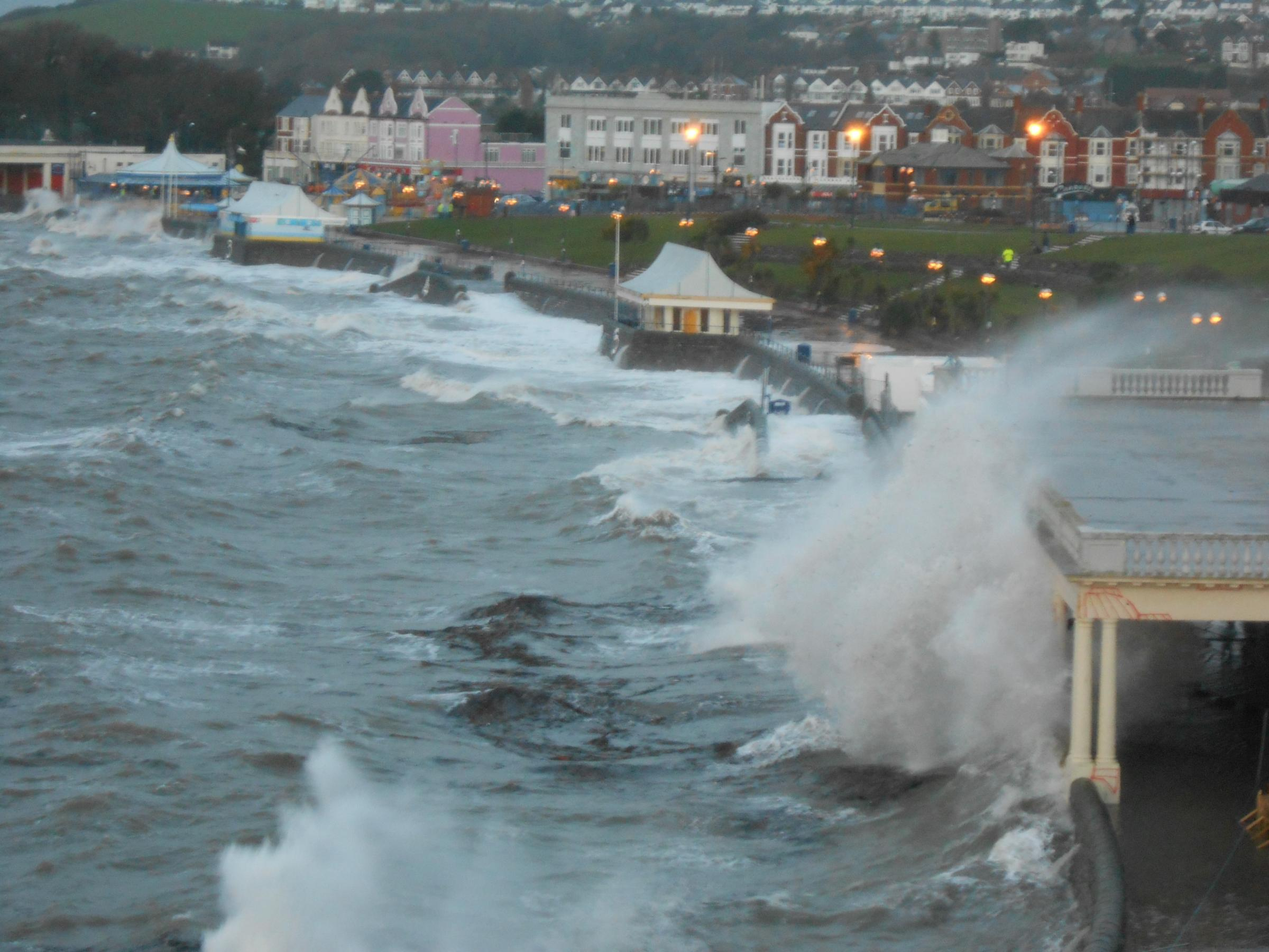 Waves invade land at Barry Island in South Wales