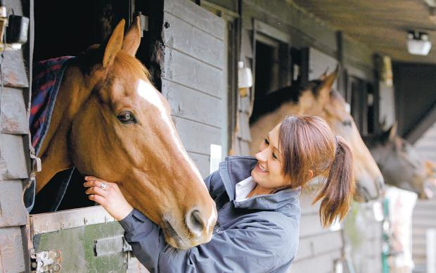 Darlington and Stockton Times: BRIGHT FUTURE: At 24, Rebecca Menzies is Britain's youngest trainer, and is based in Brandsby, near Easingwold