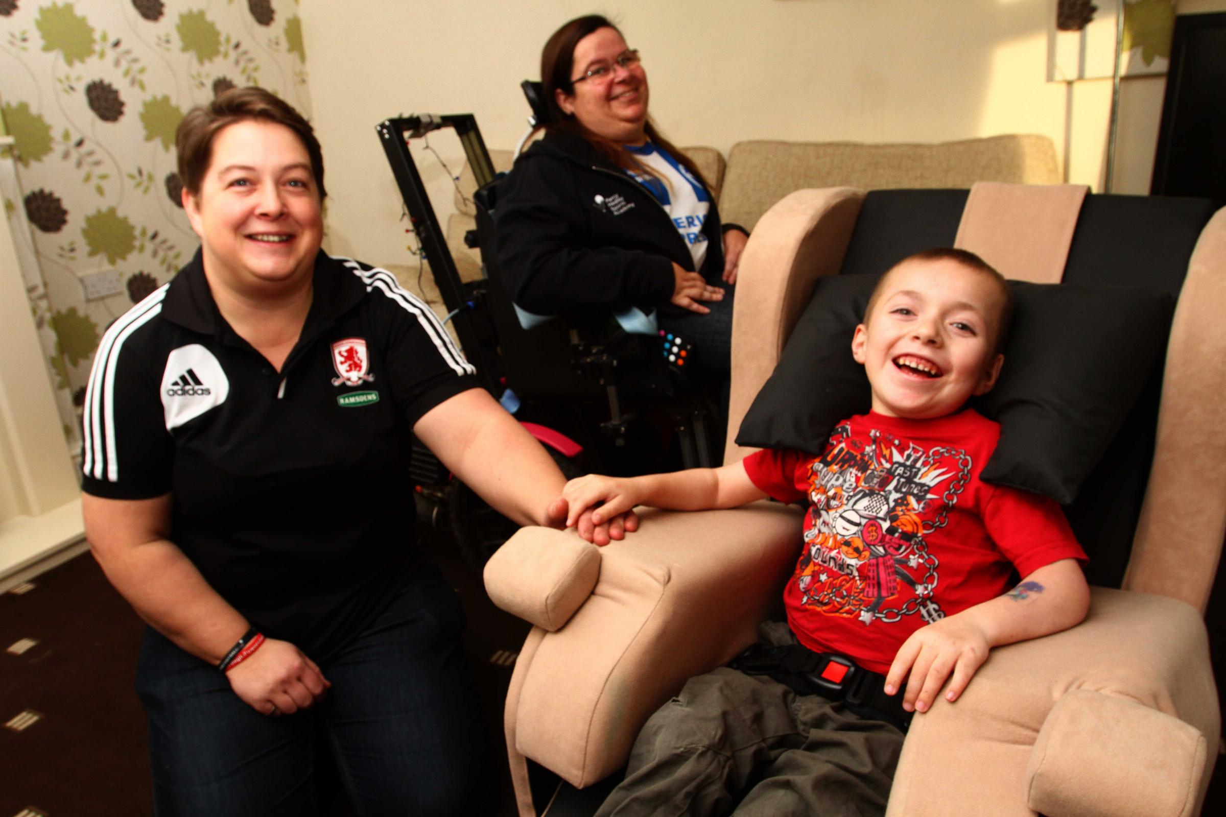 Disabled Kenzie Hughes, seven, with Middlesbrough Power Chair Football Club coaches Carolyn Bean (left) and Cath McNicol