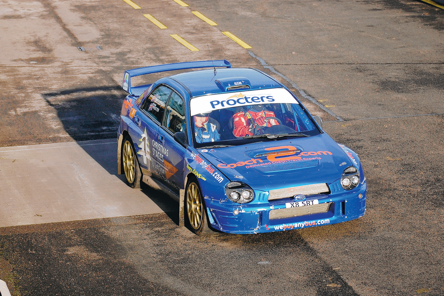 ON HIS WAY: Kevin Procter drives over the line to take victory in the Christmas Stages rally
