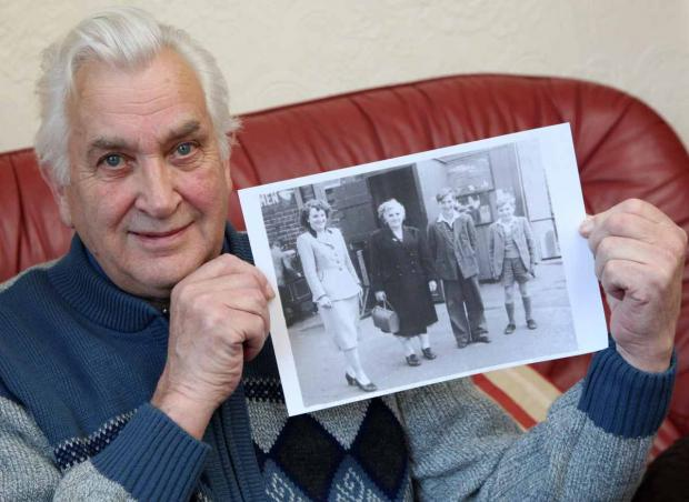 Darlington and Stockton Times: Ian Douglas with a photo of his mother on a family outing