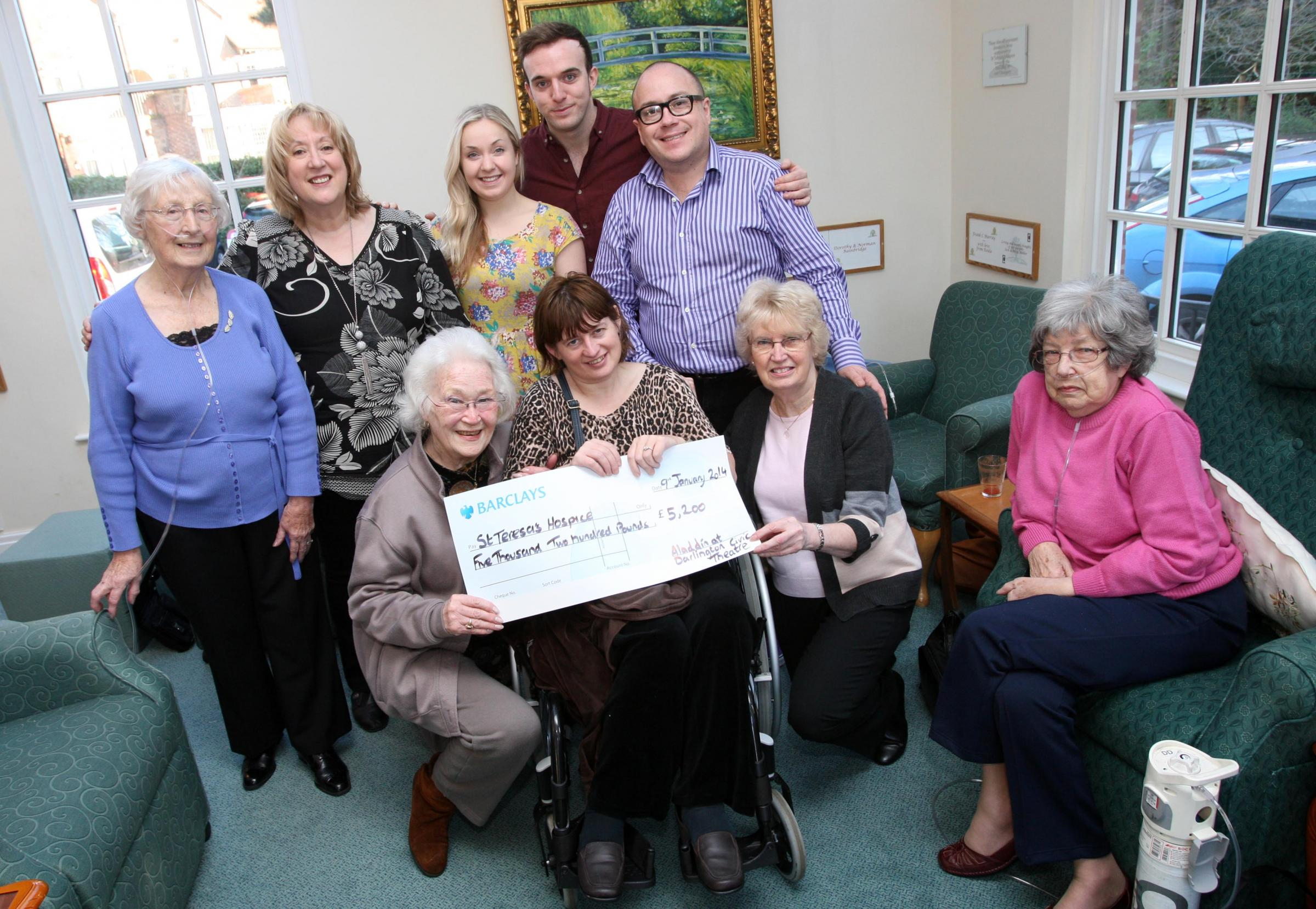 Aladdin cast members at St Teresa's Hospice to present funds raised by panto audiences (l-r) Gladys Padgett, Jane Bradshaw, Brenda Martin, Beth Stobbart, Danny Potts, Kathy Davies, Phillip Meeks, Iris Wray and Eileen Edmond