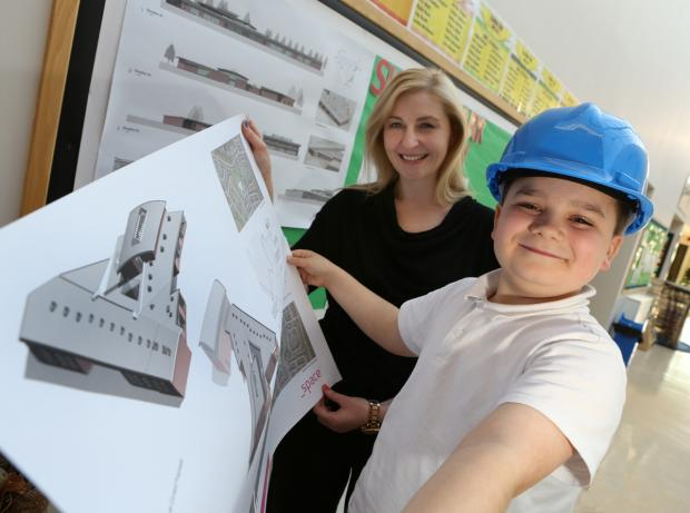 Skerne Park Academy pupil Thomas Dillon and headteacher Kate Chisholm look at plans