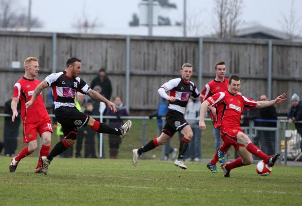 TAKING AIM: Stephen Thompson scores for Darlington against visitors Clitheroe on Saturday