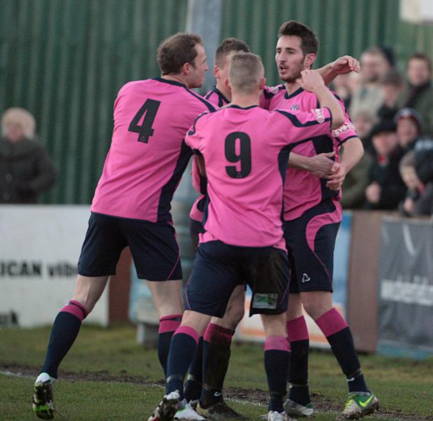 WELCOME RETURN: Joe Tait is congratulated on scoring against Harrogate RA, eight minutes into his return to Quakers
