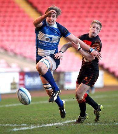 CLOSE ATTENTION: Mowden Park's Pierce Phillips chases down a ball alongside Harrogate's Callum Irvine on Saturday