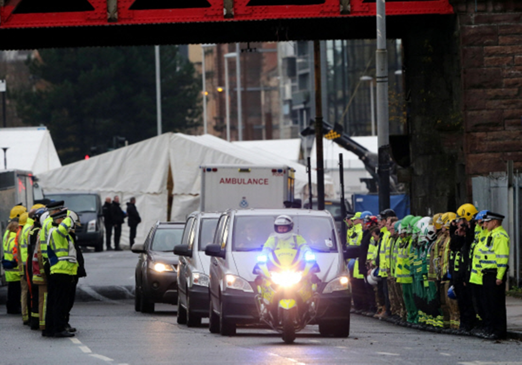Emergency services line the route as victims are taken form the Clutha pub crash