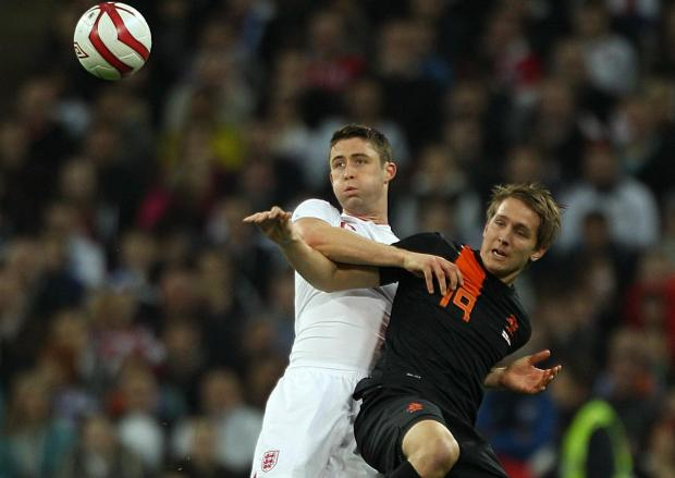 Dutchman Luuk De Jong battles Gary Cahill for the ball during the International Friendly at Wembley Stadium in 2012