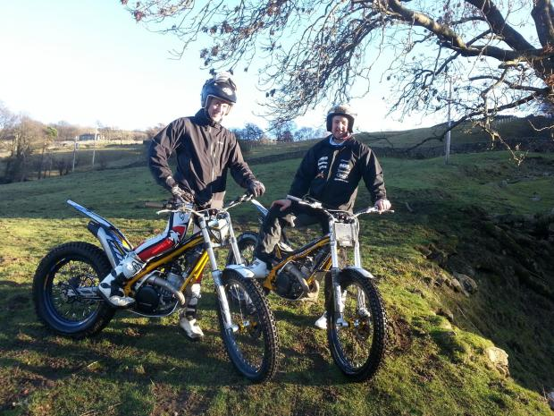 Darlington and Stockton Times: TEST RUN: Richmond Motor Club's Gavin Lowther tries out the new AGB Sherco 300cc, watched by Andrew Brown