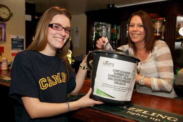 Jill Brown, landlady of the Ship Inn, makes a donation to Carys Andrews