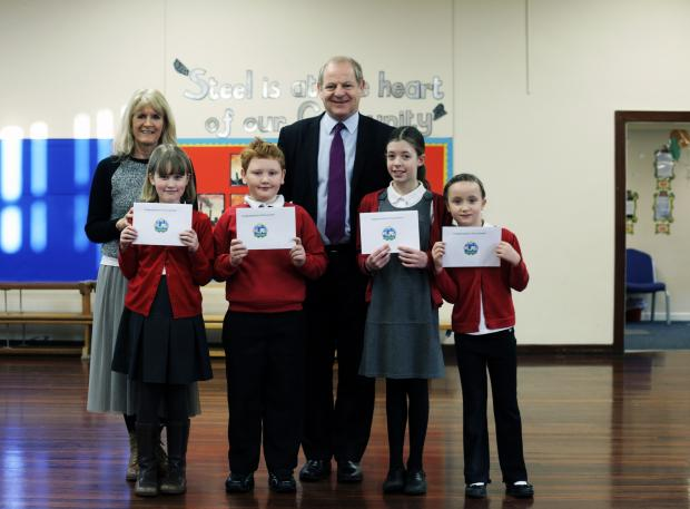Pupils with their 'Keeping the Green Clean' certificates, from left, Isabelle Stevenson 8, Cameron Lampardlow 8, Bethany Loram 11 and Josie Hayley 6, head teacher Sue Radcliffe and MP Ian Swales at Coatham Primary School in Redcar
