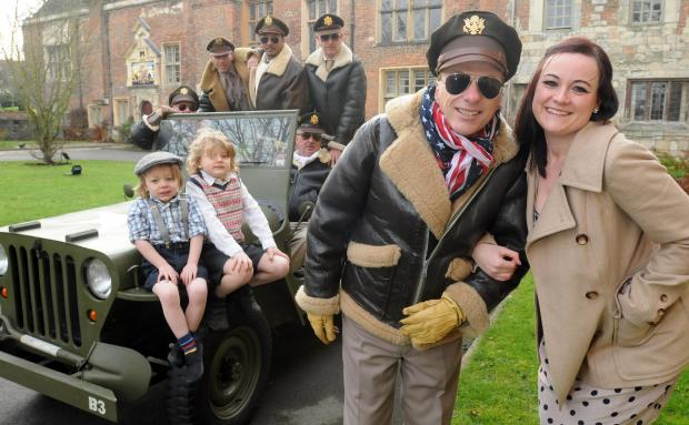 Darlington and Stockton Times: CHARITY BASH: Foreground (right) Cassie Cooper and Murray Rose and friends brought a flavour of World War Two to York when they dessed in period costumes to promote a Blitz party in aid of Cancer Research UK