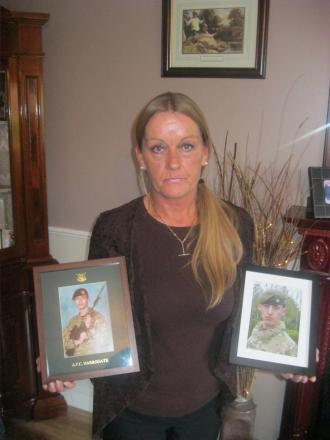 Alison Huggan with photos of her twin sons who are serving in the Army.