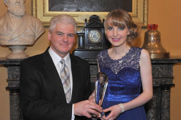 Charity founder Hannah Larkin receives her award from Middlesbrough Mayor Ray Mallon